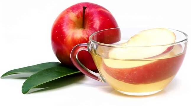 Glass of apple juice tea cyder with leaf