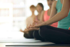 Young women yoga indoors keep calm and meditates while practicing yoga to explore the inner peace