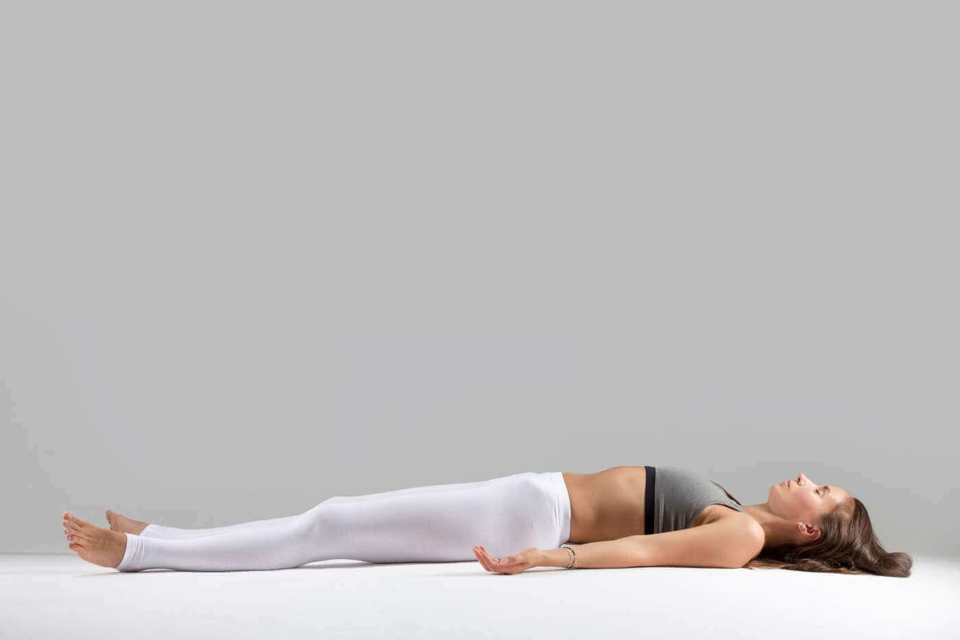 Young woman in savasana pos