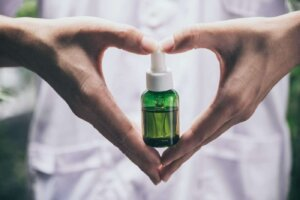 hand holding bottle of cannabis oil