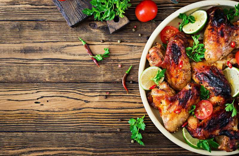 Chicken wings of barbecue in sweetly sour sauce. picnic.