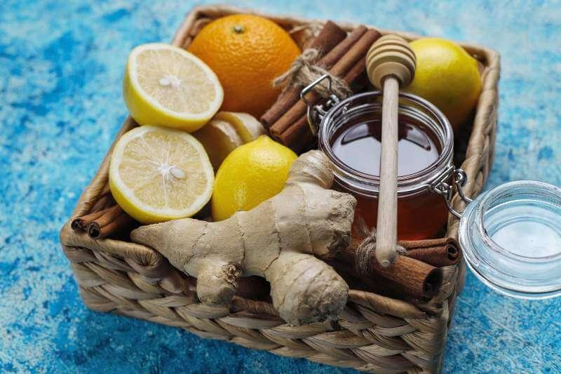 Ingredients fresh ginger lemon cinnamon sticks honey dried cloves for making immunity boosting healthy vitamin drink