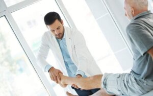 Doctor examining senior legs