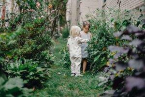 calm-stylish-children-spending-time-together-in-garden