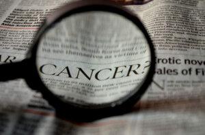 cancer-newspaper-word-magnifier