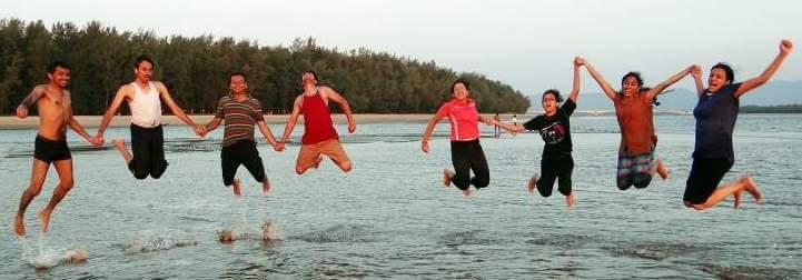 people-happy-jumping-beach