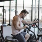 exhausted-athletic-man-training-on-exercise-bike