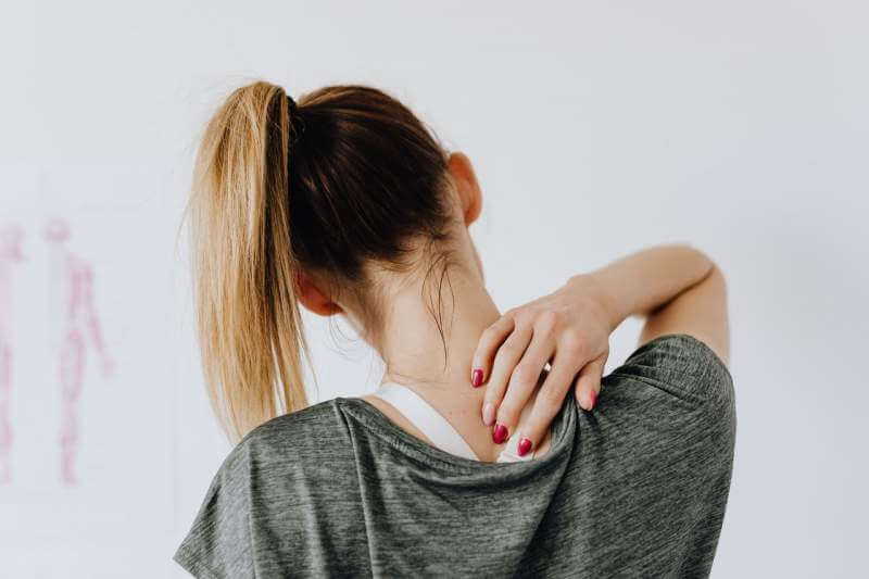 woman-neck-pain-touching-her-back-neck