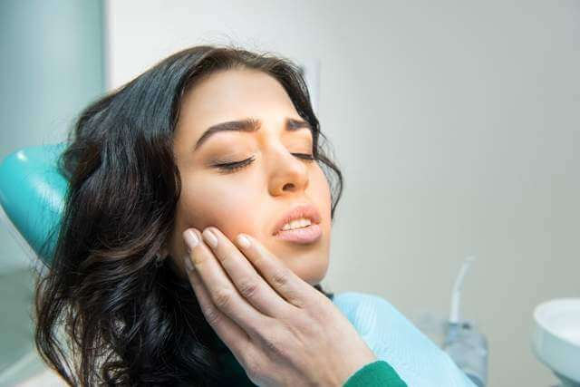 young-woman-having-toothache-due-to-teeth-grinding