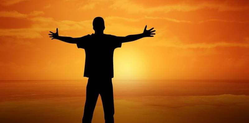 sunset-boy-open-arms-gesture